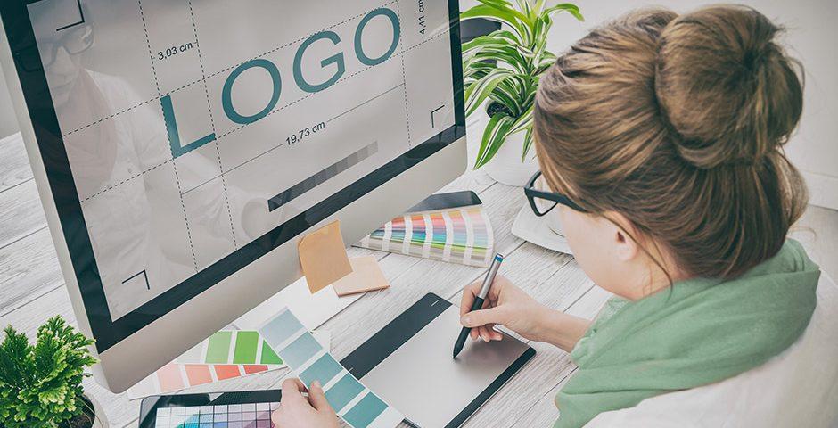 Female creating logo on imac