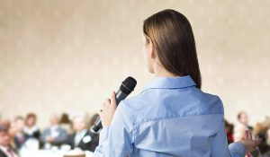 Female talking in front of audience