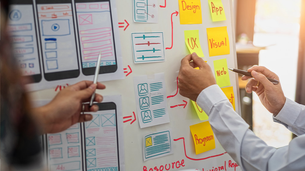 People laying out ui design